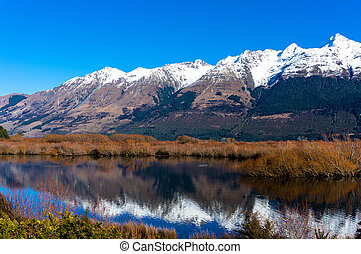 Glenorchy lagoon landscape with snow covered mountains...