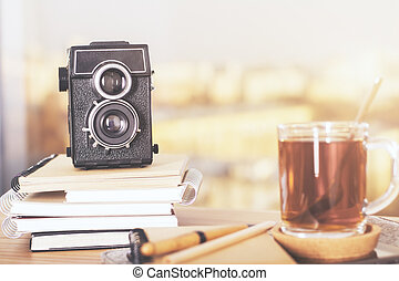 Desktop with retro camer - Wooden desktop with retro camera...