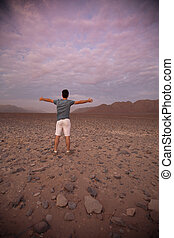 People in the Nazca desert is at sunset Peru