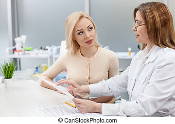Pretty young lady is visiting general practitioner -...