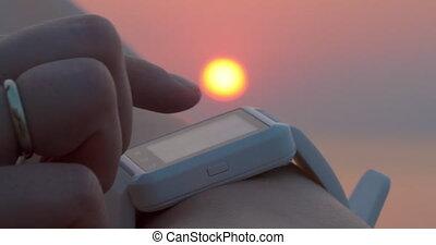 Using Smart Watch at Sunset - Closeup shot of smart watch on...