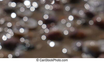 water glistens in the sun - abstract background, water...