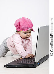 Happy crawling baby type on laptop - Happy crawling baby...
