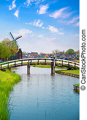 Traditional Dutch old wooden windmill in Zaanse Schans....