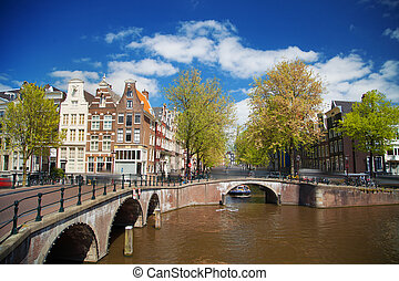 Beautiful view of Amsterdam canals with bridge and typical...