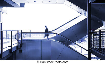 business man moving on escalator