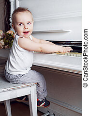 baby playing the piano - one year old baby boy playing an...