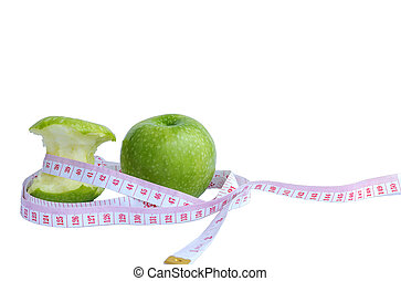 Green apple and measuring tape - Measuring tape wrapped...