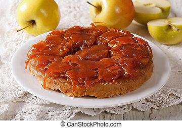 Apple pie Tarte Tatin with caramel close-up horizontal -...