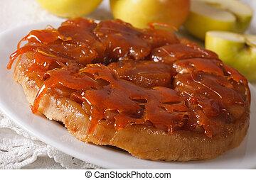 Tarte Tatin with apples and caramel close up horizontal -...