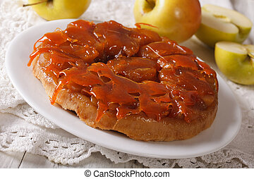 Delicious apple pie Tarte Tatin with caramel close-up...
