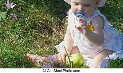 Eight month girl with flower and apple