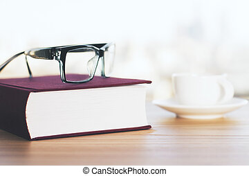 Closed book and glasses - Closed vinous book, coffee cup and...