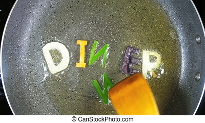 Stir-frying mixed alphabet letters, word Dinner