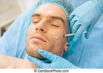 Man at the plastic surgeon - Top view of handsome young man...