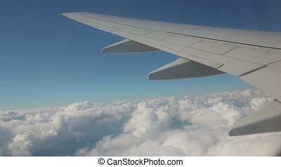 Aerial view from the airplane on cumulus clouds - Aerial...