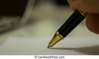 Ball pen writing on a paper by a man macro shot - Ball pen...