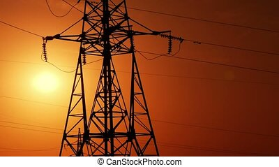 transmission line tower, sunset, time lapse