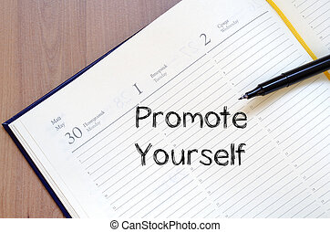 Promote yourself write on notebook - Promote yourself text...