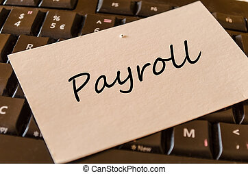 Payroll - note on keyboard in the office