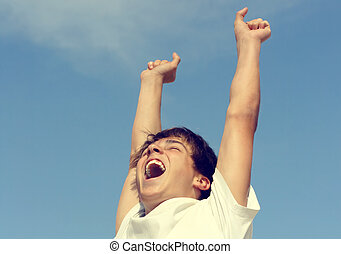 Happy Teenager with Hands Up - Toned Photo of Successful...