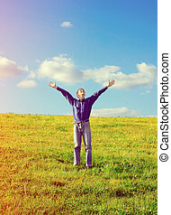 Young Man in the Field - Toned Photo of Happy Young Man with...