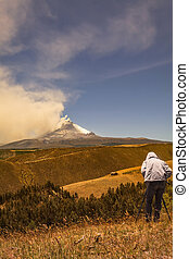 Professional man photographer posing Cotopaxi volcano -...