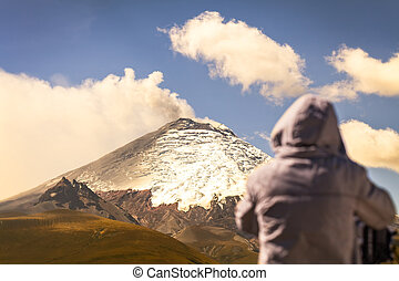 Professional photographer posing a powerful volcano...