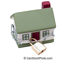 House closed in chain and padlock - The house is closed and...