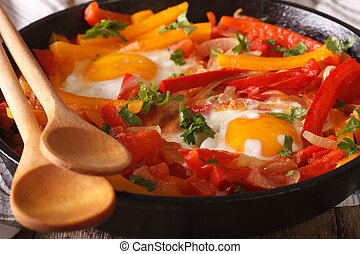 traditional Basque piperade with eggs close-up horizontal -...