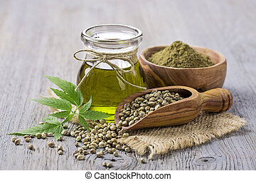 Hemp oil n a glass jar and hemp seeds
