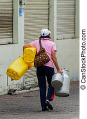 Latin Sales Woman Carrying Her Products - Hispanic Sales...