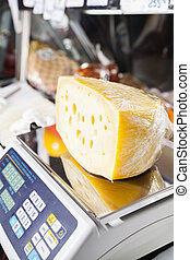 Cheese On Weight Scale In Store