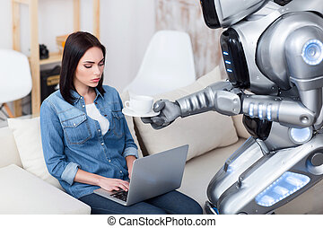Modern robot giving cup of coffee to cheerless girl - Out of...