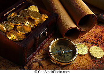Compass and a map - Old brass compass lying on a very old...