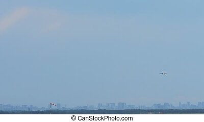 Airplane approaching before landing an early morning,...
