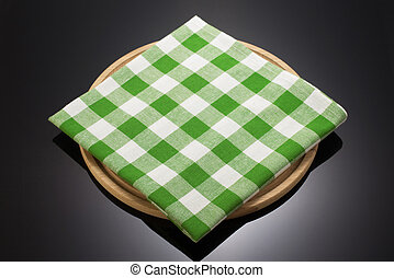 napkin cloth and cutting board on black background