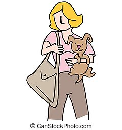 Woman holding small dog