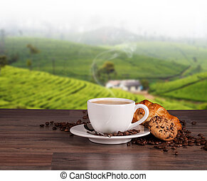 Coffee cup on wooden table, plantations background - Coffee...