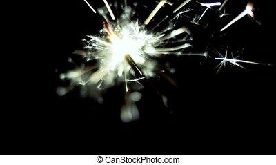 Sparkler shot against deep dark background. 50 FPS Slow...