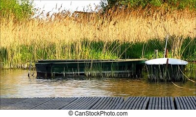 Rowboats Moored Wooden Jetty - Two small green rowboats in...