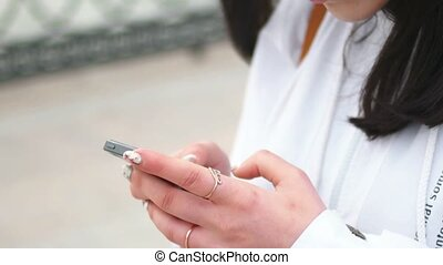 Young woman texting on cell phone
