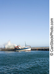 Waves pounding the harbour wall Kalk Bay , South Africa