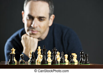Man playing chess - Chessboard with man thinking about chess...