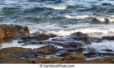 Ocean waves splashing on rocks - Ocean waves splashing on...