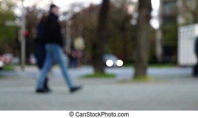 Blurry unfocused people walking