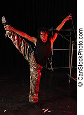 Dancers on stage - Single African male dancer dancing on the...