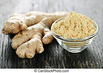 Ginger root - Fresh and ground ginger root spice on wooden...