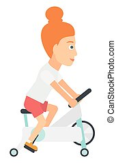 Woman making exercises - A woman exercising on a elliptical...