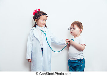 Child in a suit of the doctor with patient